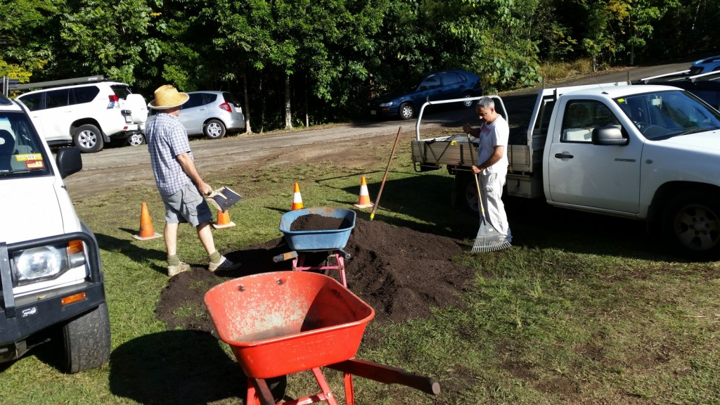 Moving the soil to fill the Raised Garden Beds